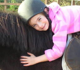 Girl leaning forward on half hour ride at Island View Riding Stables