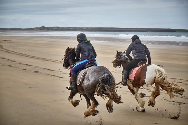 Galloping on beach